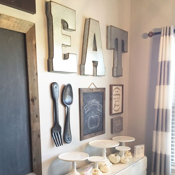 a large EAT sign, several chalkboard ones and oversized utensils