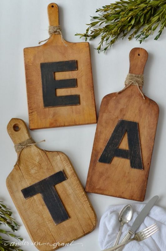 cutting board EAT art is a great rustic idea