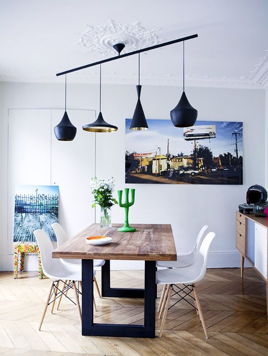 low hanging lights over dining table